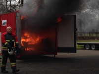 The fire takes hold of the reconstructed bedsit set up in the container. Link to View the pictures.