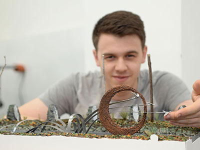 Cameron Lings with a model of his sculpture design . Link to View the pictures.