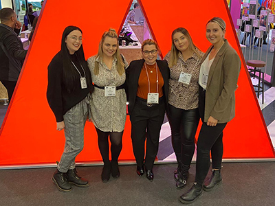Principal lecturer Beverley Boden (centre) with the prize-winning students (from left) Billie-Jo Bowie, Abbie Waldby, Megan Maguire and Megan McCullow at the Bett Show.. Link to View the pictures.
