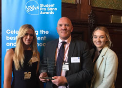 Teesside Law Clinic students, Rachel Simmons, right, Kendal Iley, left, with Andrew Perriman, Senior Law Lecturer, receiving their award at the House of Commons.