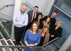 Jessica Williams, (foreground) managing director, Just Williams, with her growing team (left to right) Marc Atkinson, Joseph Kelly, Jasmine Ashley, Lucy Tyreman, Chris Garbutt, Erica Legg and Anna Caygill.