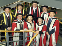 Back row: Chairman of the Governors, Sandy Anderson OBE, Chancellor Lord Sawyer, Vice-Chancellor Professor Graham Henderson, Eric Thomas , Alan Hinkes OBE. Front row: Steve Penrose , Margaret Fay OBE and Thelma Barlow.