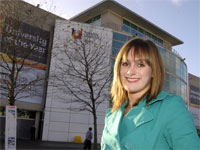 Graduate Rebecca Wood outside Teesside University library