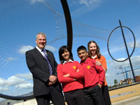 Mark Hopgood with Emma Hutchinson, 23, a Meteor student mentor, with Abingdon pupils Shaan Hussain and Heena Akram.