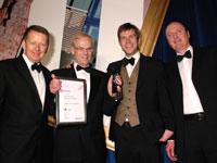 University Secretary Morgan McClintock, with Hugh Avison of CPMG Architects receiving the award from BBC News Breakfast presenter Bill Turnbull and Phil Dodd, from Sika Sarnafil.
