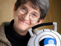 Karen Prell with Wheatley, the exuberantly delusional sphere from the award-winning video game Portal 2.