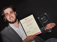 Adam Mendum with his final year award.