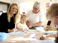 Michelle Harland of Creative Youth Opportunities (left) running an art workshop.. Link to Social enterprise is helping to inspire young people's creativity.