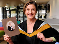 Jill Featherstone holding a photograph of her mum wearing the same graduation gown