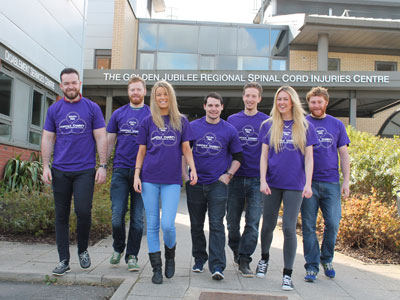 Link to Students scale the heights for spinal injuries patients.