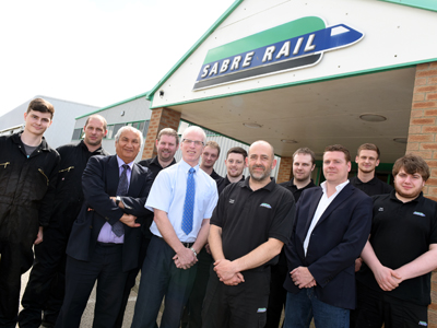 Professor Farhad Nabhani (third from left) with Sabre Rail Operations Manager Brian Capeling (fifth from left) and chief executive Stephen Thompson (third from right), along with members of staff who have completed, or are working on, qualifications at Teesside University.. Link to University partnership keeps engineering company on track to success.