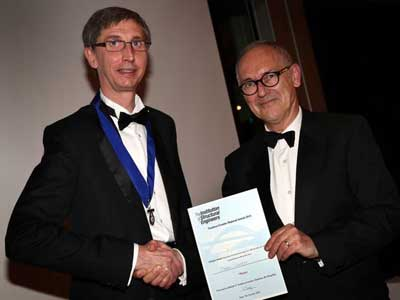 Doug Kay (left) Chairman of the Institution of Structural Engineers Northern Regions Committee, presenting the award to Barry Walmsley (right).. Link to Lifetime achievement award for Teesside University lecturer.