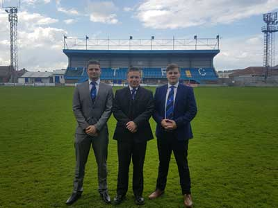 Liam Brown, Mike Edwards, Marketing Director at Whitby Town FC, and James McDonald.. Link to Liam Brown, Mike Edwards, Marketing Director at Whitby Town FC, and James McDonald..