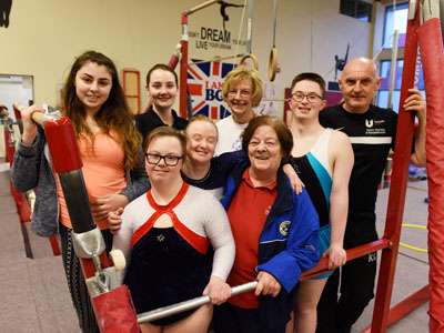 Teesside University students Leah Gibbs (back row, second left) and Kevin Gamblin (far right) with coaches and members of the Gym World Special Needs Gymnastic Team.. Link to Students help gymnasts with Special Olympics preparation.