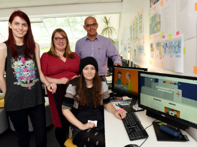 From left: Kayleigh Stevens (BA(Hons) Computer Games Animation graduate); Eleanor Land (Senior Lecturer, School of Computing); Gerard Danjoux (Consultant in Anaesthesia) and (seated) Zoe Llewellyn (BA(Hons) Computer Character Animation graduate)