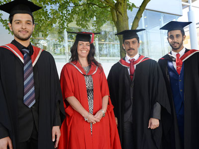Teesside University academic Melanie Brown pictured with the graduates  . Link to Teesside University academic Melanie Brown pictured with the graduates  .