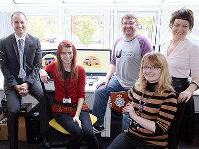 L-R: Detective Sergeant Martin Wilson, Kayleigh Stevens (Assistant Producer), Tim Brunton (Senior Lecturer and Animation Producer), Rose Gibbin (Animator) and Siobhan Fenton (Associate Dean).. Link to Computing students help tackle cyber crime.