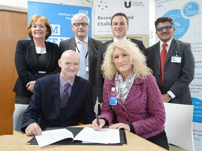Professor Simon Hodgson and Julie Gillon, with Linda Nelson, Accountable Officer at North Tees and Hartlepool NHS Foundation Trust Alan Foster, Dr Paul Williams and Professor Samir Gupta.. Link to Professor Simon Hodgson and Julie Gillon, with Linda Nelson, Accountable Officer at North Tees and Hartlepool NHS Foundation Trust Alan Foster, Dr Paul Williams and Professor Samir Gupta..