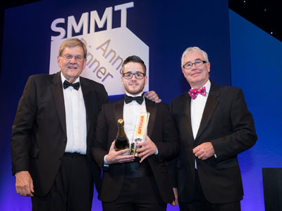 Teesside University graduate Tom Lingard, pictured centre, receiving his award