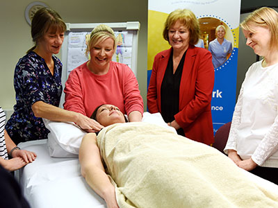 Jeanne Everett (second from left), the Lymphoedema Clinical Lead at Teesside Hospice with  some members of the first cohort of students on the course and Linda Nelson (second from right), Associate Dean (Enterprise and Business Engagement) of the School of Health & Social Care.. Link to Jeanne Everett (second from left), the Lymphoedema Clinical Lead at Teesside Hospice with  some members of the first cohort of students on the course and Linda Nelson (second from right), Associate Dean (Enterprise and Business Engagement) of the School of Health & Social Care..