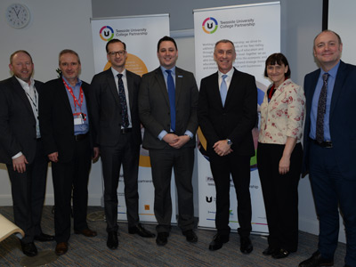 Left to right: Ed Heatley, Phil Cook, Professor Mark Simpson, Ben Houchen, Professor Paul Croney, Kate Roe and Darren Hankey.. Link to New partnership to boost higher education opportunities.