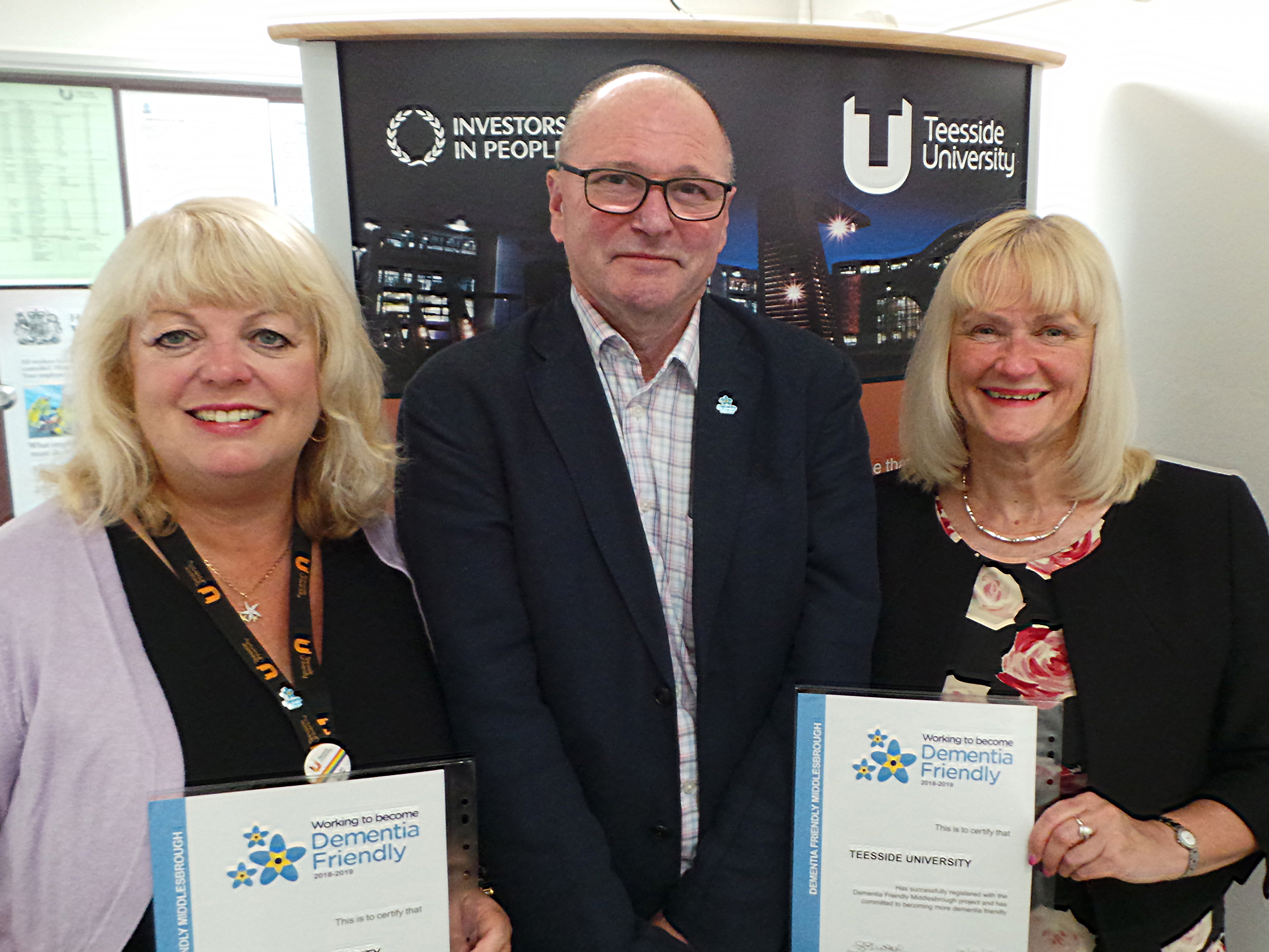 Margaret Younger, Equality and Diversity Adviser,  Juliet Amos, Director of Human Resources and Brian Rowcroft, Project Lead for Dementia Friendly Middlesbrough.. Link to University pledge to support people affected by dementia.