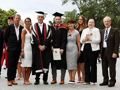 Nico's parents Maria and Tony Davison, Vice-Chancellor Professor Paul Croney, Nico Davison, Anna Kennedy, partner Theanna Desanchez, and grandparents Maria and Tony Sammarone.. Link to Degree from Teesside University keeps it in the family.