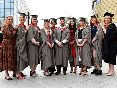 Jenny McKnight (first-left) and Linda Nelson (first-right) with some of the BMI Healthcare staff who graduated at Teesside University.. Link to Healthcare staff are the first to graduate from new programme .