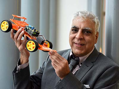 Anwar Bashir with the SmartCar. Link to Tech entrepreneur creates educational tool with help from Innovate Tees Valley.