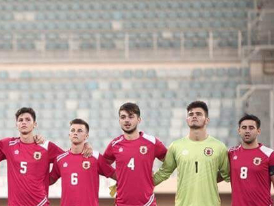 Richie Parral, centre, lining up for his country.. Link to Teesside University student flying the flag for Gibraltar.