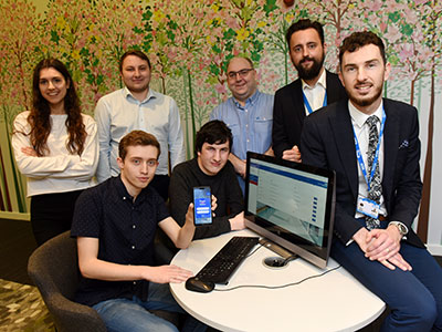 The student team from the University's School of Computing, Media & the Arts, with Adam Ruddock and Jamie Waters, from North Tees & Hartlepool NHS Foundation Trust . Link to The student team from the University's School of Computing, Media & the Arts, with Adam Ruddock and Jamie Waters, from North Tees & Hartlepool NHS Foundation Trust .