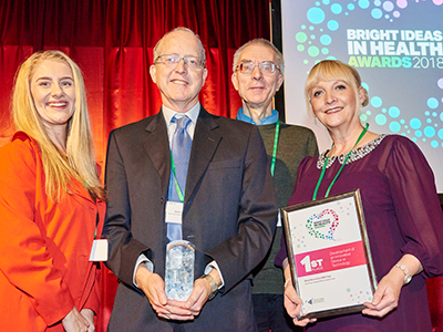 Dr David Chadwick and Professor Paul Van Schaik, (centre), receiving the Bright Ideas in Health Award. Link to New technology could lead to quicker diagnoses of infectious diseases.