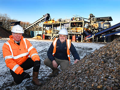 Adrian Parnaby (left) and Peter Scott are pictured with the newly commissioned £1m wash plant.. Link to Adrian Parnaby (left) and Peter Scott are pictured with the newly commissioned £1m wash plant..