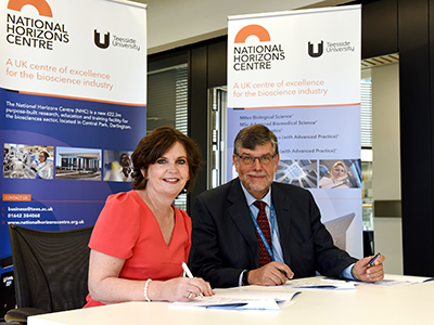 Professor Jane Turner OBE DL signing the Memorandum of Understanding with CPI Chief Executive Nigel Perry MBE. Link to Professor Jane Turner OBE DL signing the Memorandum of Understanding with CPI Chief Executive Nigel Perry MBE.