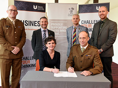 Pro Vice-Chancellor (Enterprise and Business Engagement) Professor Jane Turner OBE DL signing the Armed Forces Covenant with Lt Col Nathan Teale, Task Forces Commander Durham and Tees Valley. Alongside are (back from left) Lt Col Andy Black, Senior Engagement Officer; Gary McLafferty, North-East Director of Engagement; Darren Rhodes, Regional Employer Engagement Director; Dr David Norris, Associate Dean, Teesside University Business School.. Link to Pro Vice-Chancellor (Enterprise and Business Engagement) Professor Jane Turner OBE DL signing the Armed Forces Covenant with Lt Col Nathan Teale, Task Forces Commander Durham and Tees Valley. Alongside are (back from left) Lt Col Andy Black, Senior Engagement Officer; Gary McLafferty, North-East Director of Engagement; Darren Rhodes, Regional Employer Engagement Director; Dr David Norris, Associate Dean, Teesside University Business School..