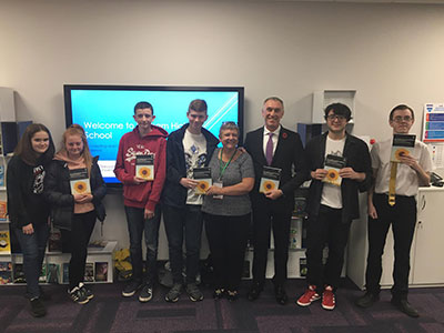 Professor Newbury-Birch, pictured at the launch of the book with Professor Croney and students from Norham High School. . Link to Professor Newbury-Birch, pictured at the launch of the book with Professor Croney and students from Norham High School. .