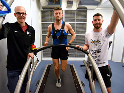 Dr Nicolas Berger with Michael Bleasby and Tom Walker in the environmental chamber. Link to University facilities prepare fundraisers for gruelling Gambian run.