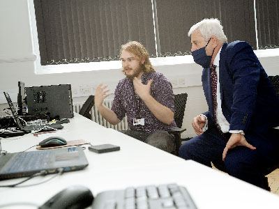 Teesside University Chancellor Paul Drechsler CBE (right)  talking to Thomas Beckensall, Creative Director of Omniplay Games Ltd.. Link to Six new games companies powered up by Teesside University.