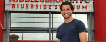 Christian Burgess pictured during his degree studies . Link to Study stays an important goal for footballer.