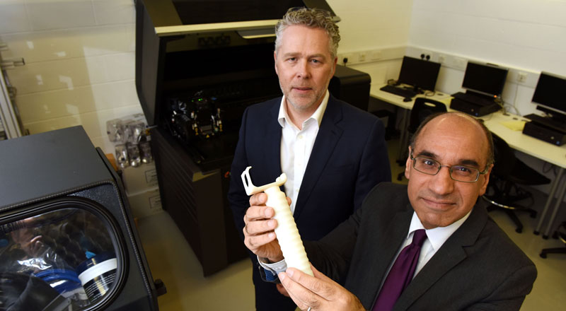 Professor Andrew Owens (left) and Professor Zulf Ali with the prototype handle.