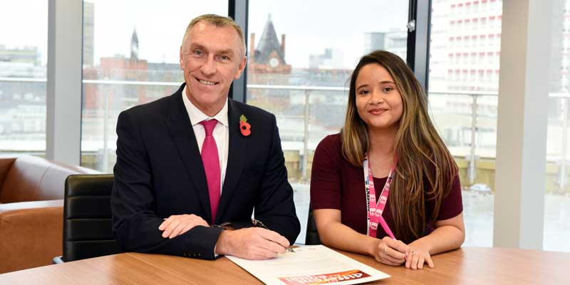 Vice-Chancellor and Chief Executive of Teesside University Professor Paul Croney signs the All Different, All Equal pledge with the President of the Students' Union Bruna Silva.