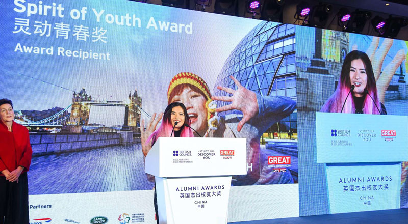 Zhao Jing, BA (Hons) Television and Film Production graduate, pictured in China receiving her Spirit of Youth Award