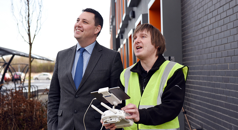 Ben Houchen (left) is shown how to fly the drone by Chris Young of Rectrix
