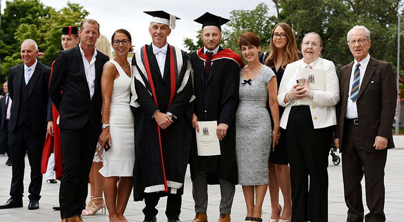 Nico's parents Maria and Tony Davison, Vice-Chancellor Professor Paul Croney, Nico Davison, Anna Kennedy, partner Theanna Desanchez, and grandparents Maria and Tony Sammarone.