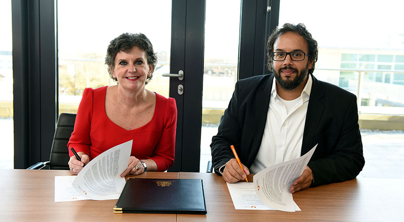 Pro Vice-Chancellor (Enterprise and Business Engagement) Professor Jane Turner OBE DL signing the memorandum of understanding with Mark South, Chief Operating Officer at Double Eleven.. Link to University pledges to collaborate with leading games company.