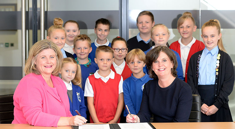 Katrina Morley, Chief Executive of Tees Valley Education and Professor Jane Turner OBE DL, Pro Vice-Chancellor (Enterprise & Business Engagement) at Teesside University, with pupils from Tees Valley Education.
