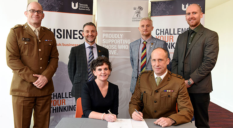 Pro Vice-Chancellor (Enterprise and Business Engagement) Professor Jane Turner OBE DL signing the Armed Forces Covenant with Lt Col Nathan Teale, Task Forces Commander Durham and Tees Valley. Alongside are (back from left) Lt Col Andy Black, Senior Engagement Officer; Gary McLafferty, North-East Director of Engagement; Darren Rhodes, Regional Employer Engagement Director; Dr David Norris, Associate Dean, Teesside University Business School.. Link to University recognised for support for veterans.