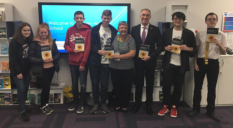 Professor Newbury-Birch, pictured at the launch of the book with Professor Croney and students from Norham High School.