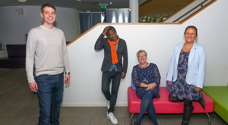 Poet Lemn Sissay (second left) with the organisers of the Hackathon (from left) David Dixon, Investment Manager at DigitalCity, Rachel Morris, Principal Lecturer in the School of Health & Life Sciences and Dr Daisy Best, Principal Lecturer in the School of Social Sciences, Humanities & Law. [Photo credit: Gordon Williams, neurologically-challenged.co.uk]