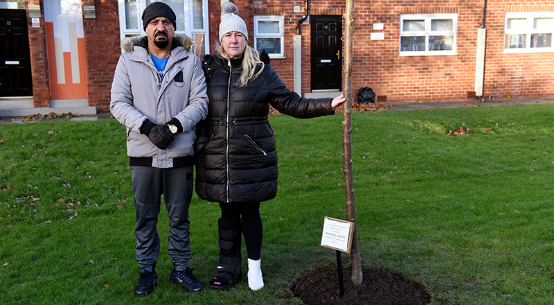 Tan and Michelle Hanif with the memorial tree for Michael.